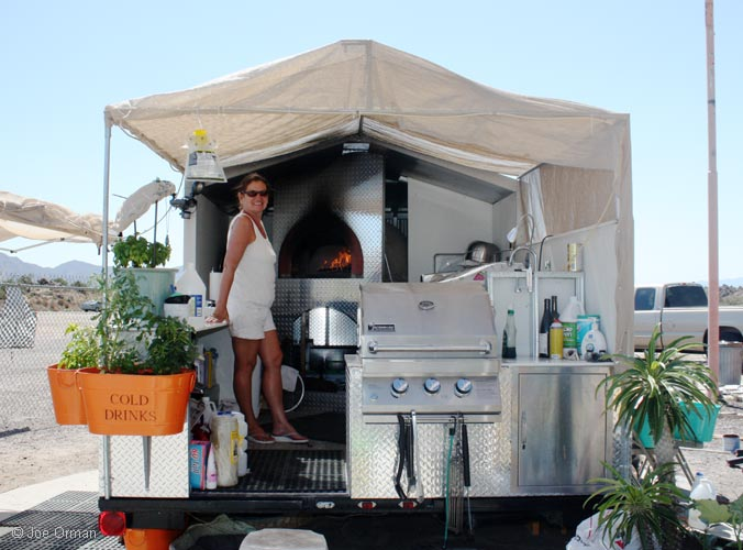 Bonnie in her wood-fired pizza oven trailer.